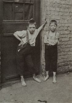 """This is one of a series of photographs in a collection known as """"the Spitalfields Nippers of 1912 as photographed by Horace Warner. Although the origin of these pictures is an enigma, these frisky nippers of a century ago require no introduction or explanation, because they assert themselves as the mettlesome inhabitants of their territory."""" (http://spitalfieldslife.com)"""