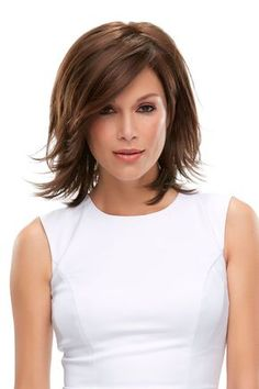 Layered bob-style with layers upon layers and a lace front hairline. The side-swept fringe bang is loaded with longer-layers.