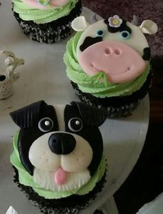 Fondant cupcake toppers.  Cow cupcake topper.  Border Collie cupcake topper.