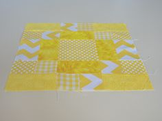 """A traditional block pattern called """"Antique Tile Block"""" pieced by Pam Wilson in September 2014, incorporating gingham and other fabrics from the stash of my aunt Johanna Wackerle Tanner."""