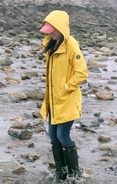 Braving the Maine shoreline in a classic yellow Nautica slicker. A stylish raincoat is a closet must-have in New England. Pvc Raincoat, Yellow Raincoat, Girls Wear, Women Wear, Rain Gear, Girls In Love, Rain Boots, Lady, How To Wear