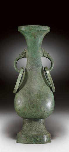A LARGE BRONZE HU-FORM VASE - YUAN DYNASTY (1279-1368).
