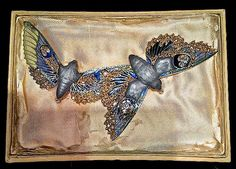 """The piece de resistance of the collection, however, is this very rare and superb Lalique """"Night Moths"""" brooch, mostlikely from1907. In its original box from the Place Vendômeshop, the piece was given to the owner by her sister on the day of her wedding and had amazingly remained within the same family until 2012. As the gallery states, """"This is the most significant work of art Macklowe Gallery has ever offered for sale."""""""