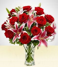 This is one of our most popular arrangements. Stargazer lillies and roses in a crystal vase. Valentine Flower Arrangements, Rose Arrangements, Love Rose Flower, Beautiful Flowers, Large Flower Pots, Flower Vases, Diy Wedding Bouquet, Wedding Flowers, Grave Flowers