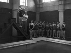 This novice swimmer is instructed on the proper form for a dive during his 1955 lesson.
