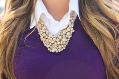 purple sweater with white button down and cute chunky necklace. cute and preppy.