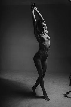 Grayscale Photo of Woman in Bikini Stretching