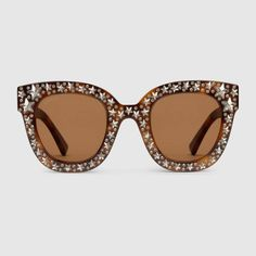Shop the Cat eye acetate sunglasses with stars by Gucci. null