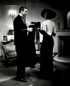 In Manhattan Melodrama shown below from 1934, Dolly Tree designed a fabulous backless gown for Myrna Loy. It is especially striking with the long gloves and hat.