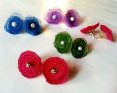 I wanted to share this fabric flower stud earrings tutorial for a while and finally here it is! This instructable will show how to make these cute fabric flower stud earrings in few simple steps. You can make these cute colorful flower ear-tops for yourself or as a gift.