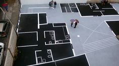 pre construction installation: artist maider lopes draws the plans at full scale.