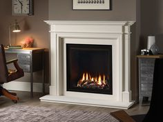 Stone Fireplace Mantel with a large Log Effect Gas Fire House Inspiration, Limestone Mantel, French Fireplace Surround, Contemporary Gas Fireplace, Gas Stove Fireplace, Gas Fires, Fireplace Surrounds, Fireplace, Gas Fires And Surrounds