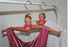Altered Barbie clothes hangers.....are you freaking kidding me creepy
