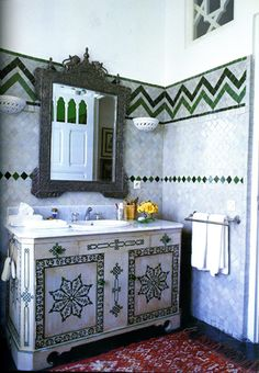 A modern way to mix green tile patterns by Alberto Pinto. Not sure if I like graduated paint colors on walls. Green and white cabinets could look beachy, but here has a Mexican flair. Decor, Tile Inspiration, Boho Bathroom, Bathroom Decor, Green Tile, Interior, Bohemian Bathroom, Bathroom Design, Bathroom