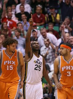 With a bandage on his head Utah's Al Jefferson points to the sky after making a late basket as he powers the Jazz to a victory and into the playoffs against the Suns at EnergySolutions Arena in Salt Lake City, Utah Tuesday April 24, 2012. (Steve Griffin/The Salt Lake Tribune)