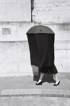 Black umbrella lady at the Père Lachaise Cemetary, Paris
