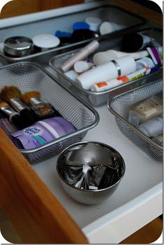 Velcro dollar store containers to the bottom of the drawer so they don't slide around- Perfect for Make up & Jewelry!
