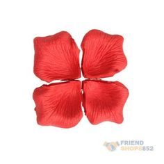 Red rose petals for centre piece, cake table and ceremony aisle