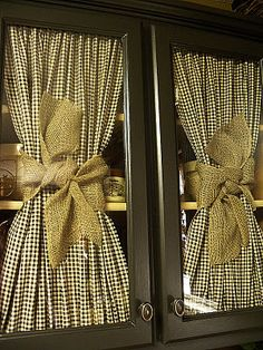 Love the idea of ruched fabric when your missing the glass for cabinet doors! So country shabby chic!