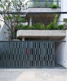 Image 1 of 40 from gallery of House / TNT architects. Photograph by Triệu Chiến