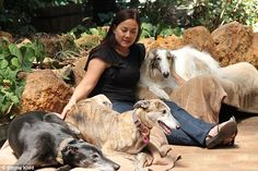 Emma Kidd who runs a clinic specialising in Bowen therapy for dogs is pictured here with h...
