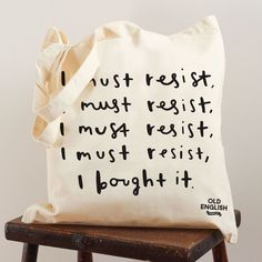 This simple and stylish shopping tote bag would be the perfect gift for the shopaholic friend! The typographic tote bag has been illustrated with the hand lettered words 'I must resist, I must resist,. Sac Tods, Bag Quotes, Best Tote Bags, Fashion Quotes, Women's Fashion, Fashion Bags, Fashion Jewelry, First Aid Kit, Canvas Tote Bags