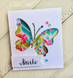 Negative die cut butterfly shaker card with sequins [white card with patterned paper inside of shape]