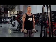 Dumbbell shrug exercise instructions and video | Weight Training Guide