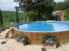 Placing flower boxes around your above ground pool walls is a good landscaping idea.