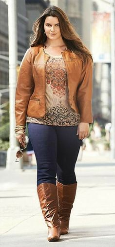 Thick girl in cognac leather jacket jeans and boots