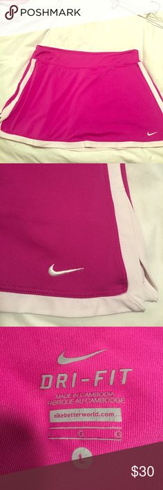 Nike Magenta Tennis Skirt, Size Large Great tennis skirt, excellent condition! Nike Skirts