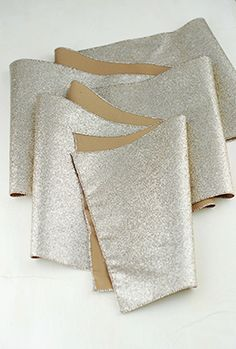 14.99 SALE PRICE! Create a dazzling tablescape using this Glitter Table Runner in platinum. This glamorous table runner will add just the right amount of spa...