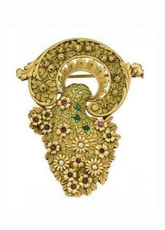 An emerald, ruby, enamel, and yellow gold floral brooch.