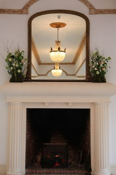 Mantelpiece design at Northbrook Park created from winter flowers. Image taken by Galileo Photography