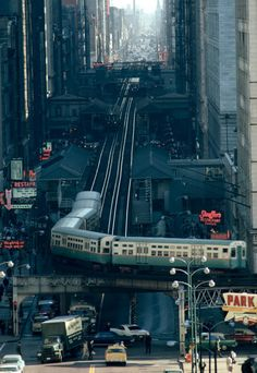 The El, Chicago by James L. Stanfield, most likely from the Chicago Sun-Times Building, in the June 1967 issue of National Geographic. It shows an L train turning from Wabash Avenue left onto Lake Street. National Geographic, Puente Golden Gate, Rare Historical Photos, Rare Photos, The Blues Brothers, S Bahn, My Kind Of Town, Abbey Road, Chicago Illinois