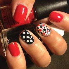 Polka dots nail art with red and black nails.