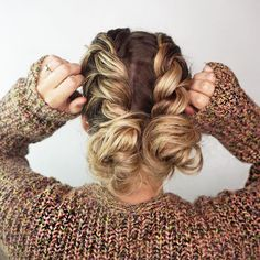 Two Dutch braids, two messy buns. Fun, playful hairdo.