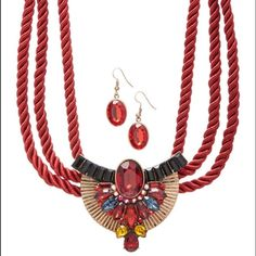"""Red Beaded Twist Statement Necklace&Drop Earrings. This bold statement piece flaunts twisted chain, gleaming beads and a captivating centerpiece for an unforgettable look.  Top it off with the matching earrings.  Necklace: 17"""" L with 3"""" extender, 2.75"""" drop.  Earrings: 1.5"""" L,  lobster claw clasp,  Goldtone-plated zinc / goldtone plated steel / acrylic/ glass / polyester. Davinci Jewelry Necklaces"""