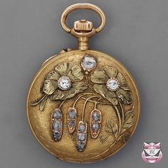 Art Nouveau hunter case pocket watch c1900, manufactured by 'Cronometro Escasany', Argentina. 30mm in diameter, 18K yellow gold, old mine-cut & rose-cut diamonds, repouss work, white enamel dial, textured guilloch pattern.  |  http://www.faycullen.com/antique_watches/950/fo703w1d.html