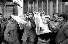 Demonstrators for Ayatollah Shariat Madari tear up Khomeini's portrait in Tabriz, 1980. Violent incidents between partisans of the two ayatollahs (Khomeini and Shariat Madari) broke out 4 January 1980 in Tabriz, the capital of Iranian Azerbaijan, Shariat Madari's native region.