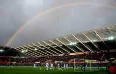 Swansea, UK:   A rainbow appears during a soccer match at the Liberty Stadium on Jan. 14.