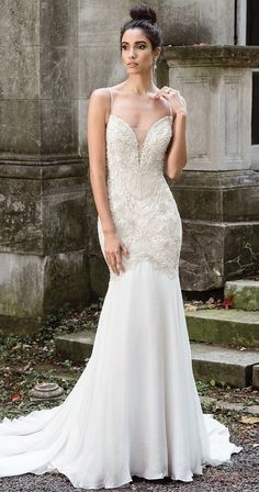 Mermaid Wedding Dresses : Ensure all eyes are on you. Opulent hand beading and a dramatic plunging V-neckl