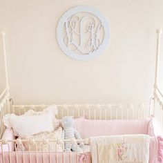 Love the scalloped monogram above the crib