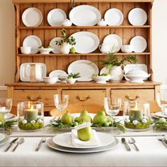 Pretty pear green table scape. White earthen ware plate display. Just simple and elegant.
