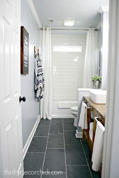 Idea for upstairs hall bath.Love the large tile floor and the open storage in the sink area. Subway Tile Showers, Bathroom Showers, Thrifty Decor Chick, Small Toilet, Modern Farmhouse Bathroom, Bathroom Wallpaper, Bathroom Flooring, Basement Bathroom, Wood Flooring