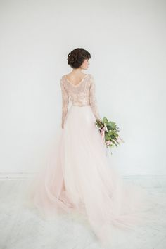 This dress is so delicate and airy like a cotton candy! The top part is made with unique franch lace in light bronze color (limited edition) and fully lined with a softest blush silk. The neckline is embroidered by hand with rhinestones, crystals and beads. The skirt is made with many layers of blush tulle and lined with ivory silk satine. The dress has left side zipper clozure. Optionally this dress can be made in different color (white/ivory for more traditional look)  PLEASE NOTE!  - All…