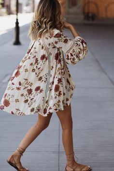 Bohemian flowy dress with floral print and brown lace up sandals