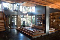 Living room with a sunken design. By Sagemodern.