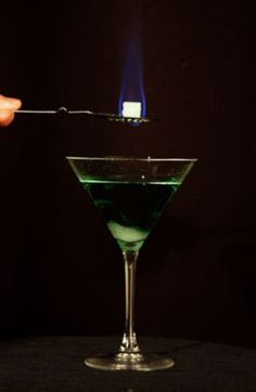 Czech Method: 1. Pour a shot of Absinthe into a glass; 2. Dip a teaspoon of sugar in the absinthe so that it absorbs it; 3. Set the sugar cube on an Absinthe spoon and place it on the glass; 4. Light the sugar cube on fire and allow all the caramelized sugar to flow into the glass; 5. Pour the water into the glass, stir and enjoy!