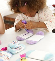 Cool activity: Have your guests turn dollar-store socks into cute slippers with puffy paint.